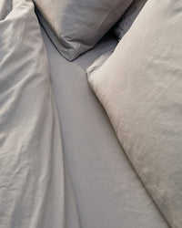 silver grey bedding set in an industrial bedroom