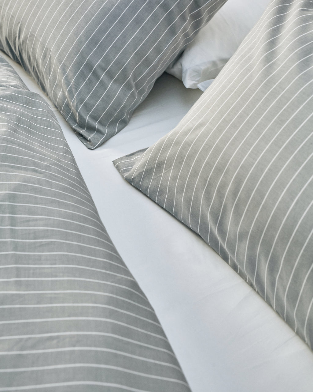 grey and white striped cotton bedding texture