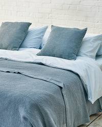 light blue luxury bedding set with blue waffle bedspread and scatter cushions