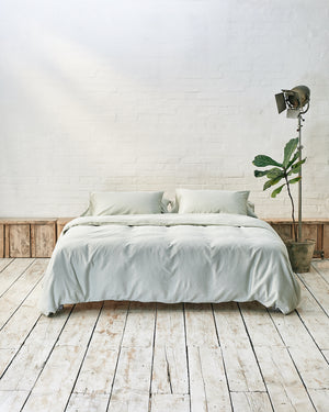 light green duvet cover set on a platform bed