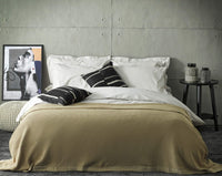 beige luxury soft bedding set in loft apartment