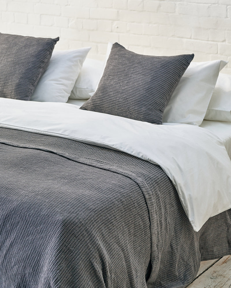 white luxury bedding set with darkg grey waffle bedspread and scatter cushions