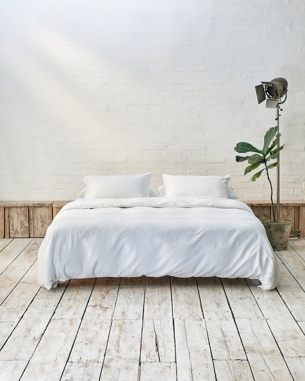 White bedding set in an industrial bedroom