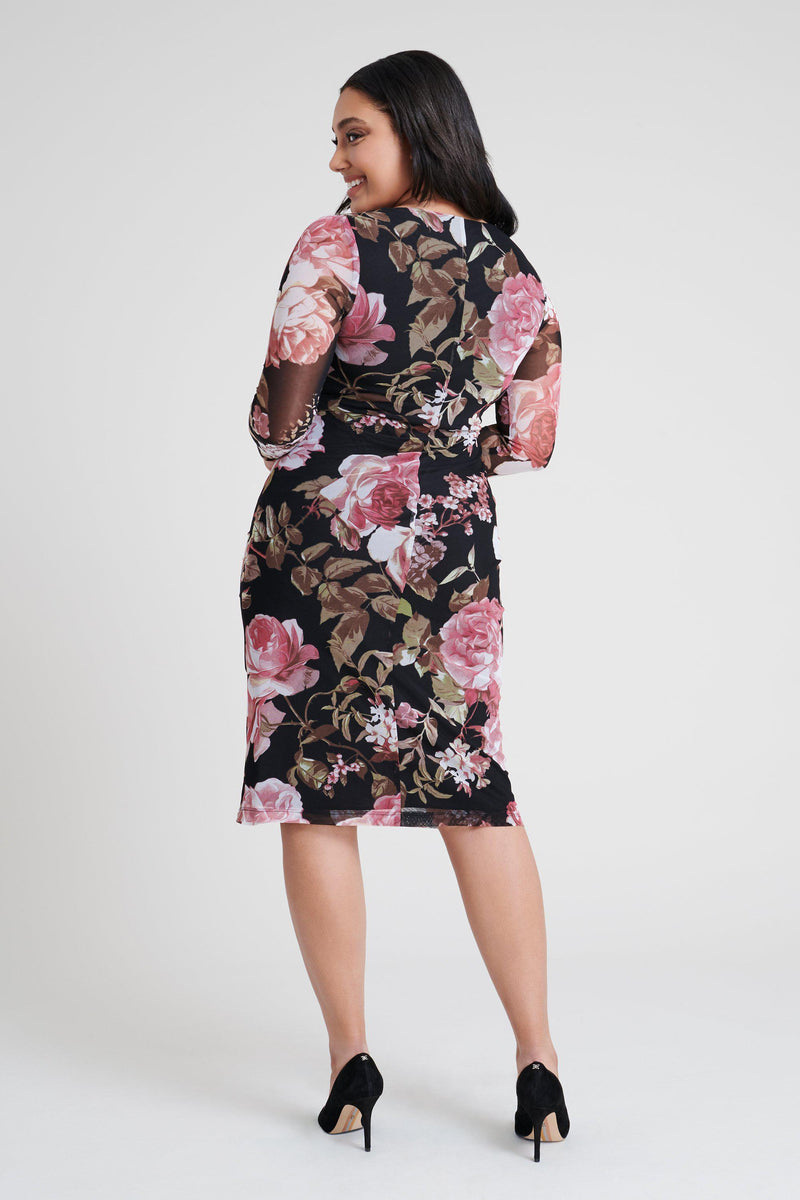 woman-wearing-connected-apparel-Amber Floral Print Dress-posing-on-plain-background
