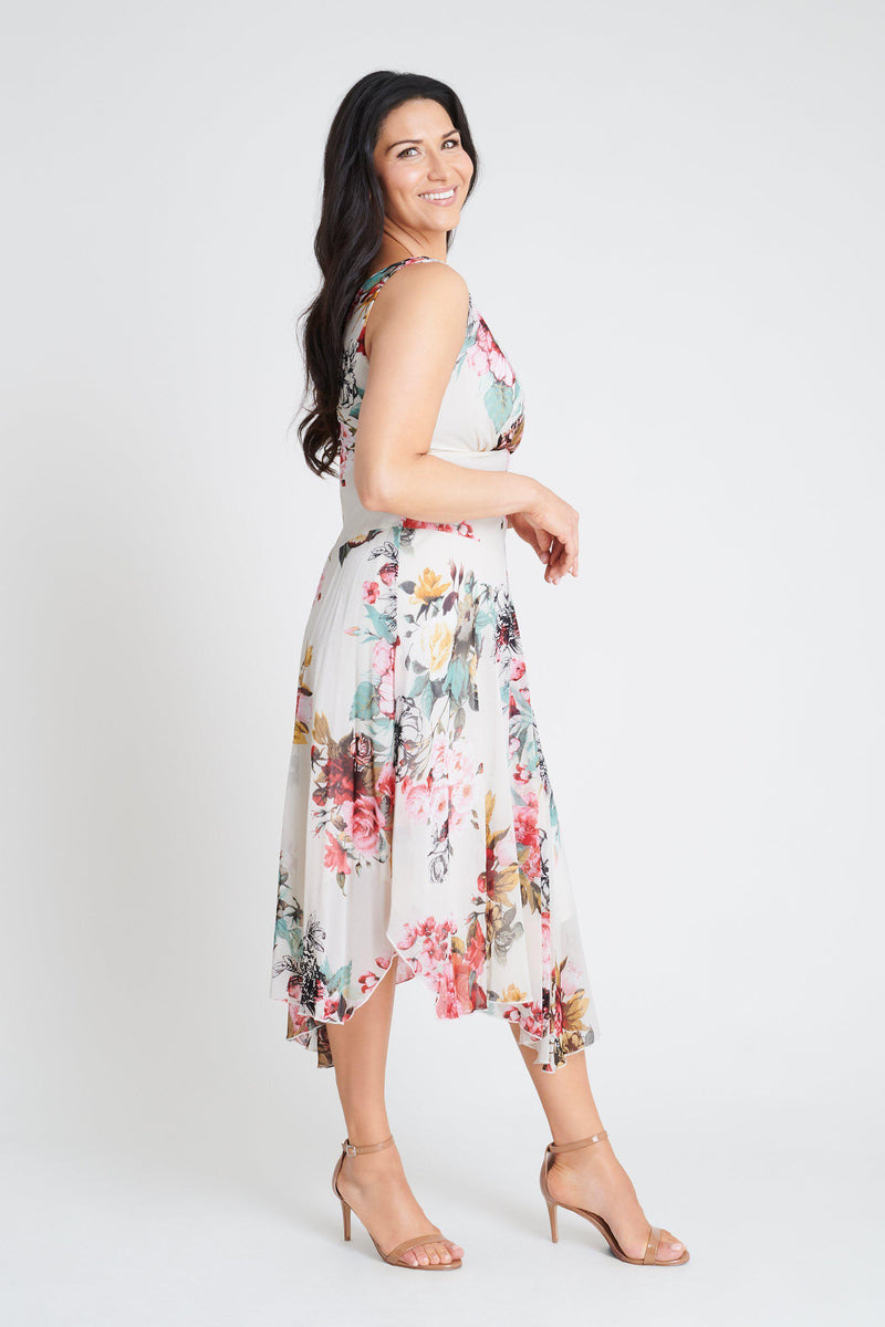 Woman posing wearing Pink Audrey Pink Floral Print Asymmetrical Dress from Connected Apparel