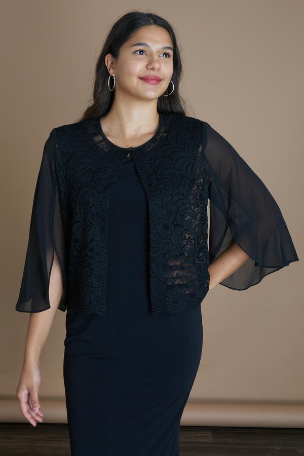 Woman posing wearing Black Denise Scalloped Lace Shrug from Connected Apparel
