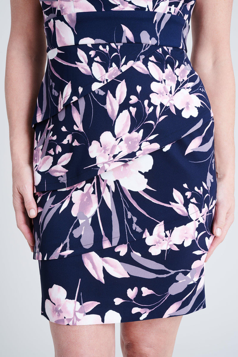 woman-wearing-connected-apparel-Cassie Navy & Mauve Floral Print Dress [PRE-ORDER]-posing-on-plain-background