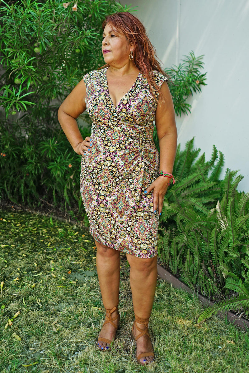 Woman posing wearing Gold Celine Gold Mosaic Print Sleeveless Dress from Connected Apparel