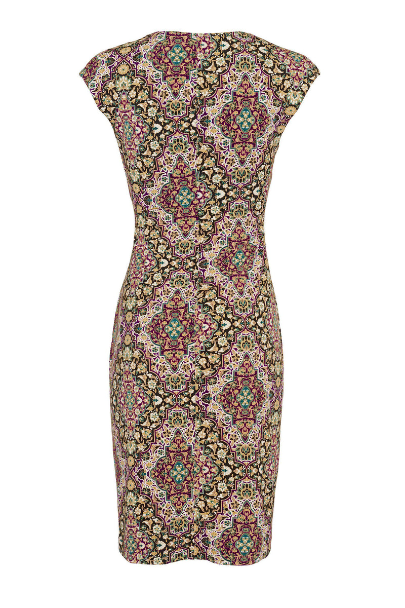 Woman posing wearing - Celine Gold Mosaic Print Sleeveless Faux Wrap Dress from Connected Apparel