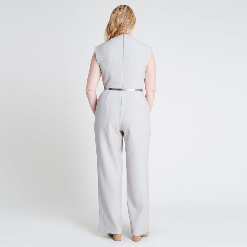 Woman posing wearing Taupe Heather Taupe Belted Jumpsuit from Connected Apparel