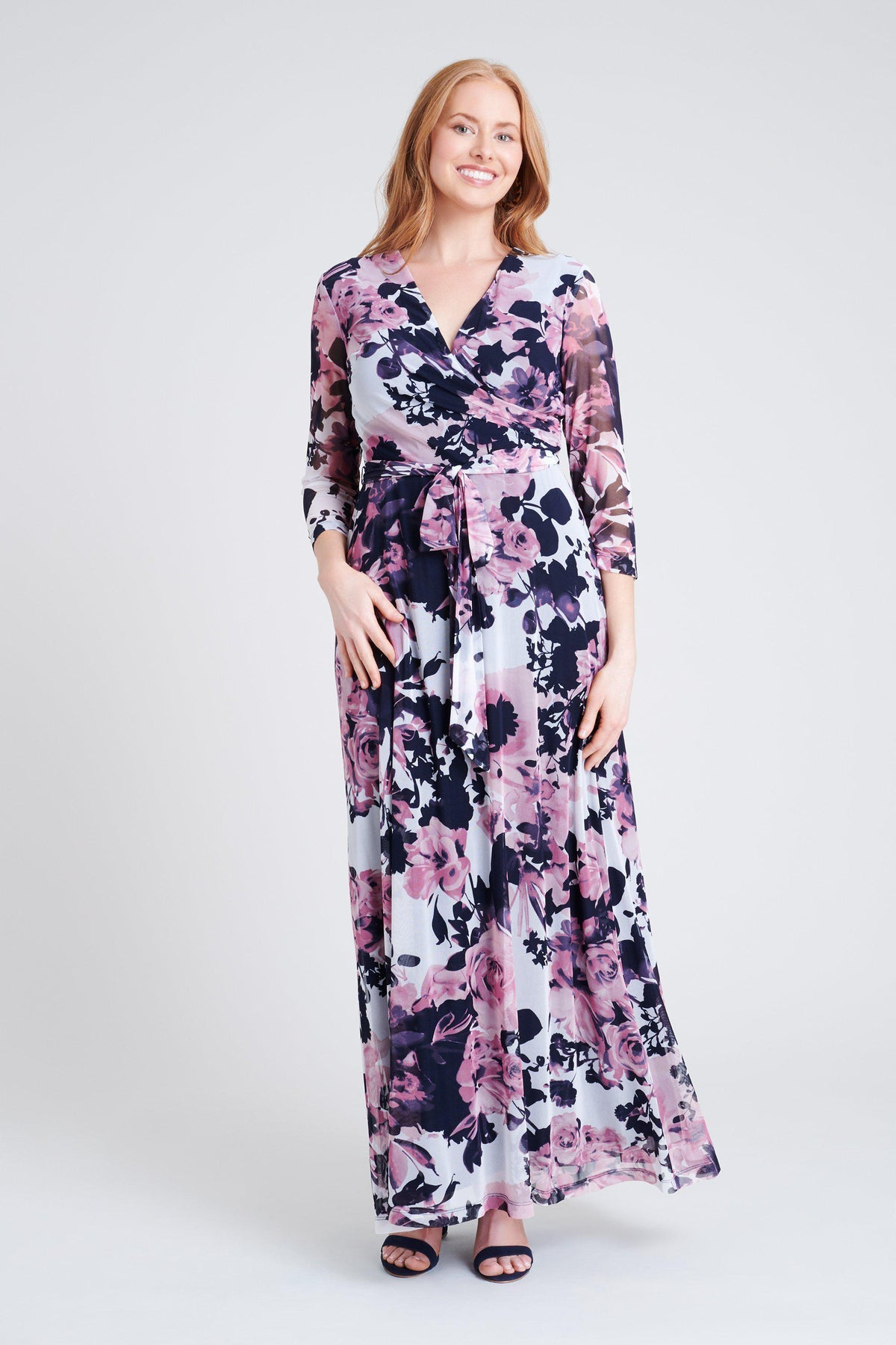 woman-wearing-connected-apparel-Krista Floral Print Wrap Maxi Dress-posing-on-plain-background
