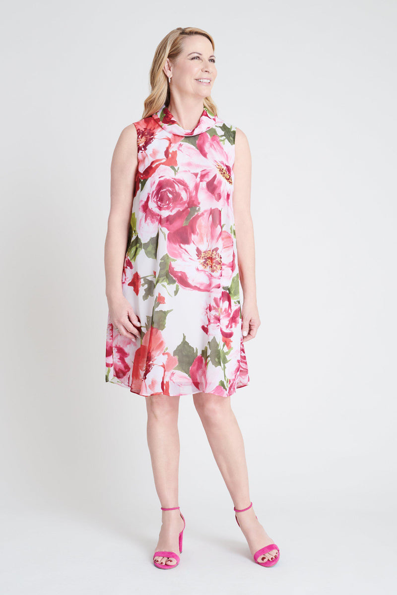 Woman posing wearing Ivory/Pink Kennedy Floral Print Dress from Connected Apparel