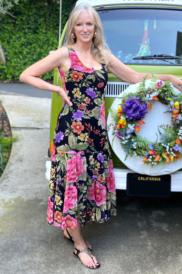 Woman posing wearing Black Juliette Floral Print Sleeveless Dress from Connected Apparel