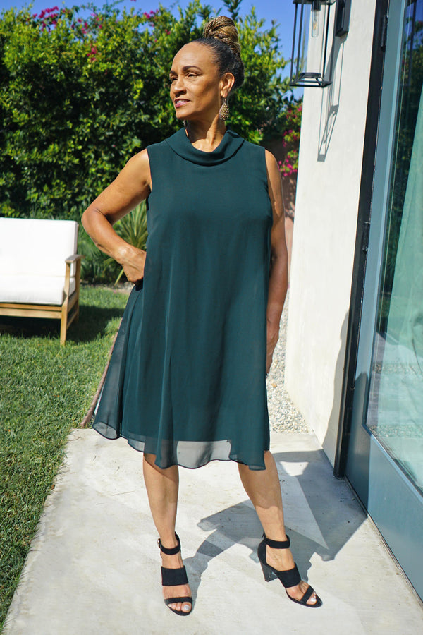 Woman posing wearing Dark Green Kennedy Dark Green Knee Length Dress from Connected Apparel