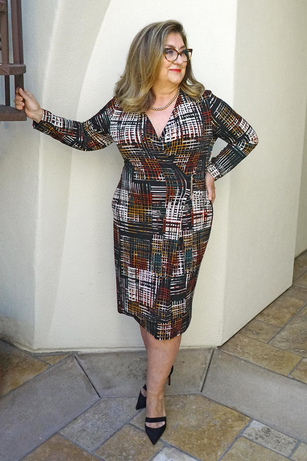 Woman posing wearing Rust Kori Printed Long Sleeve Wrap Dress from Connected Apparel