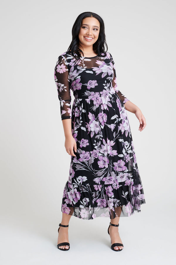 woman-wearing-connected-apparel-Leigh Floral Print Midi Dress-posing-on-plain-background