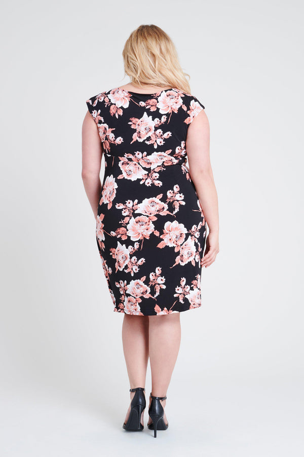 woman-wearing-connected-apparel-Lisa Cameo Floral Print Dress-posing-on-plain-background