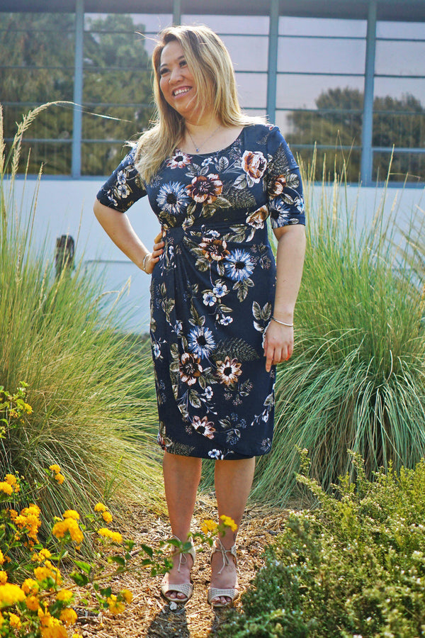 Woman posing wearing Deep Teal Lisa Deep Teal Floral Knee Length Dress from Connected Apparel