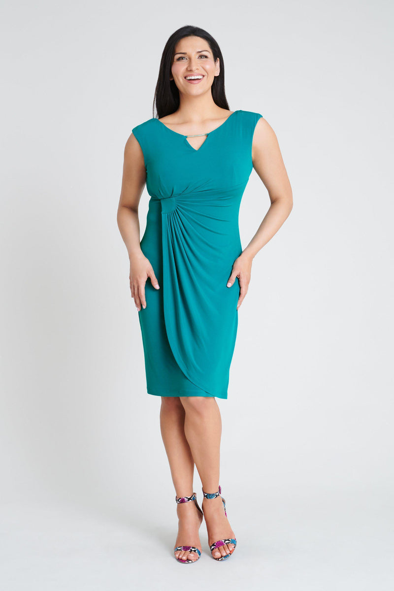 Woman posing wearing Seafoam Lisa Seafoam Sleeveless Dress from Connected Apparel