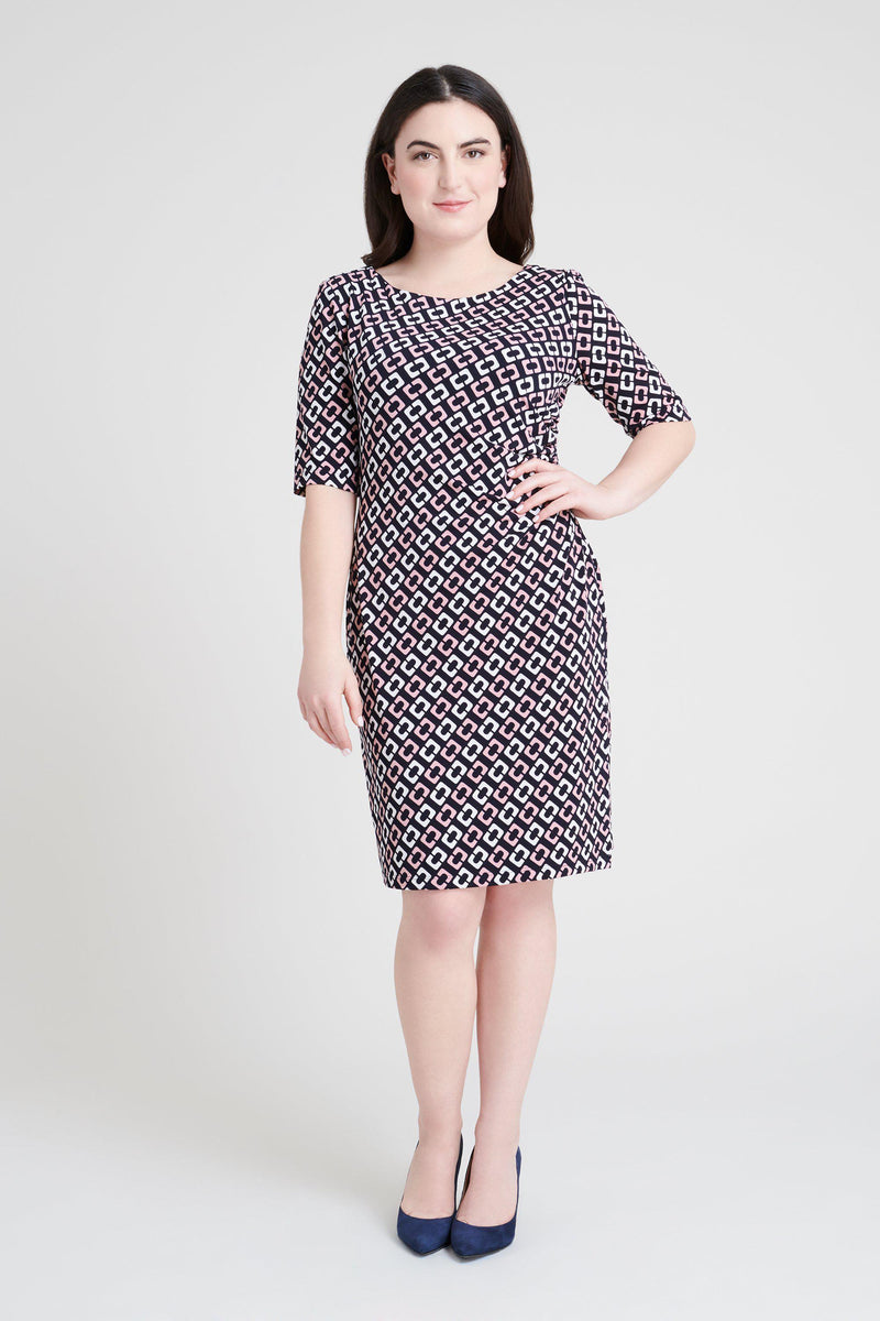 woman-wearing-connected-apparel-Liz Mauve Geometric Dress-posing-on-plain-background