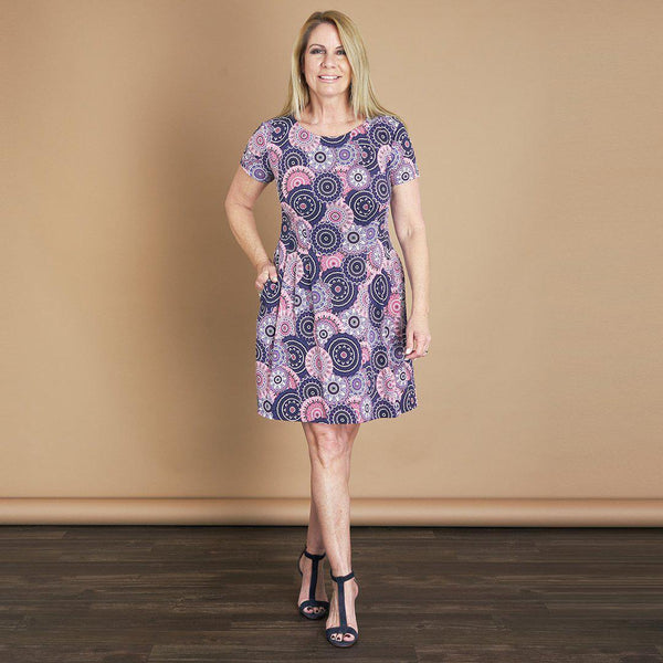 Woman posing wearing Mauve Maggie Fit & Flare Abstract Print Short Sleeve Dress from Connected Apparel