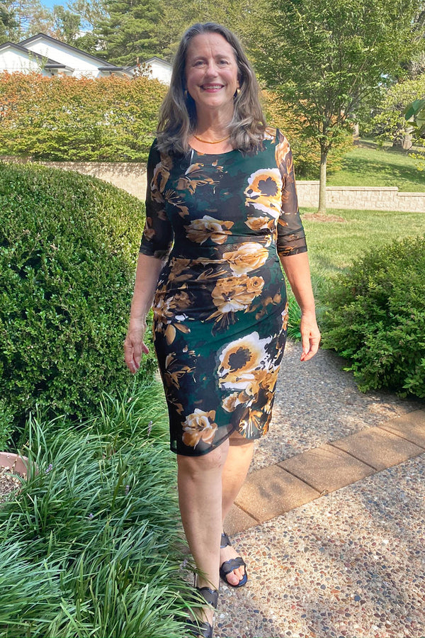Woman posing wearing Hunter Mandy Hunter Knee Length Floral Dress from Connected Apparel