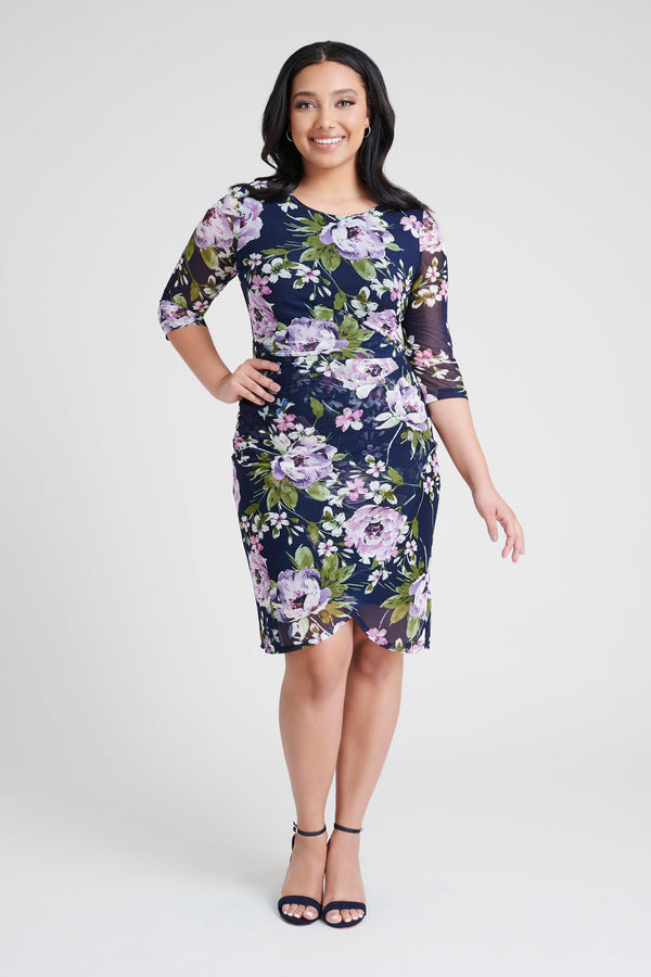 woman-wearing-connected-apparel-Mandy Navy Floral Print Dress-posing-on-plain-background