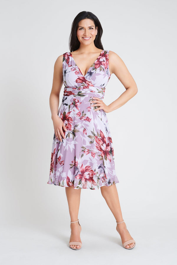 Woman posing wearing Mauve Cora Mauve Floral Pink Dress from Connected Apparel