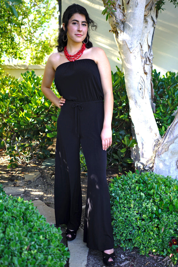 Woman posing wearing Black Melissa Strapless Black Jumpsuit from Connected Apparel