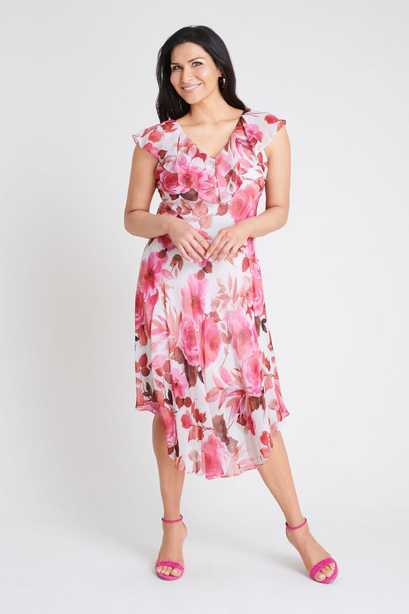 Woman posing wearing Pink Melody Pink Floral Print Dress from Connected Apparel