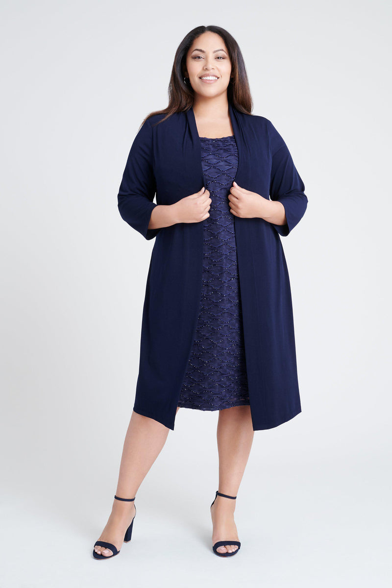 Woman posing wearing Navy Monica Navy Jacket Dress from Connected Apparel