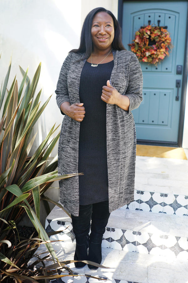 Woman posing wearing Charcoal Monica Sweater Knit Jacket Dress from Connected Apparel
