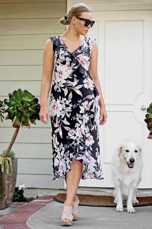 Woman posing wearing Navy Natalie Navy Floral Print Wrap Dress from Connected Apparel