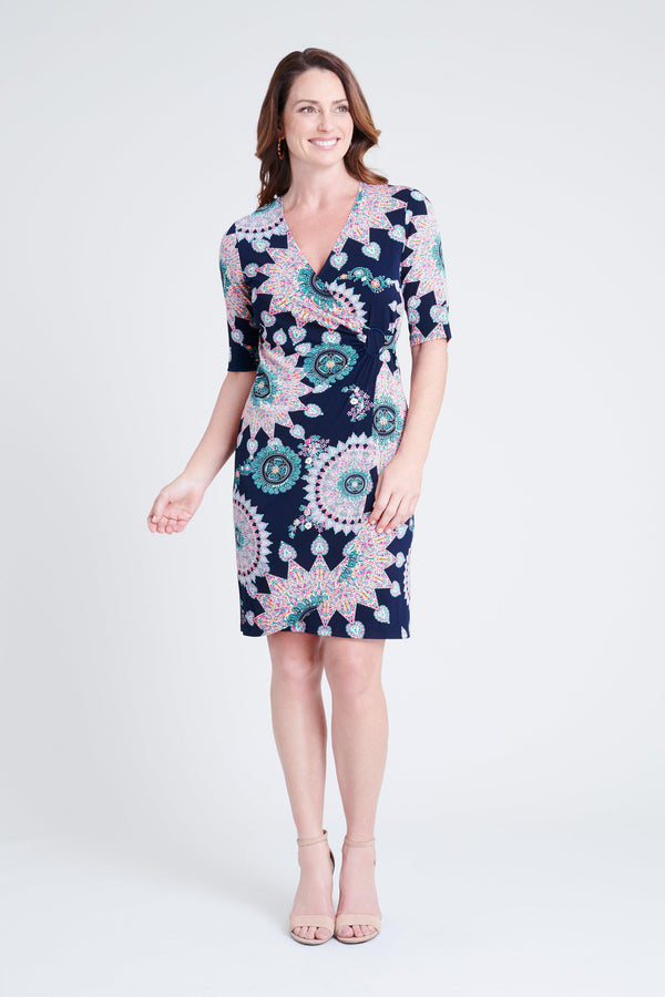 woman-wearing-connected-apparel-Gina Navy Print Dress [PRE-ORDER]-posing-on-plain-background