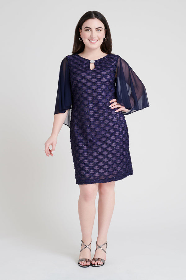 Woman posing wearing Navy/Mauve Frankie Navy & Mauve Eyelash Metallic Capelet Dress from Connected Apparel