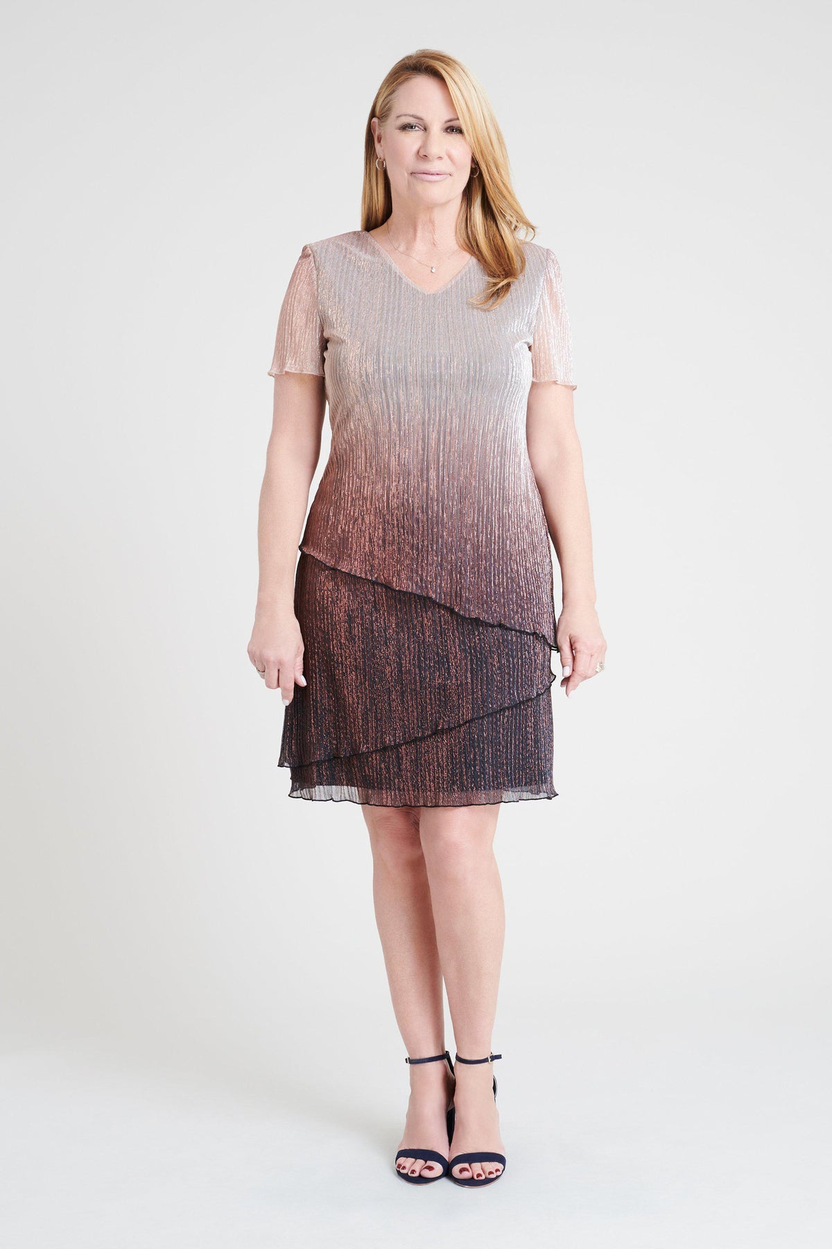 Woman posing wearing Pink/Mauve Penny Ombre Metallic Dress from Connected Apparel