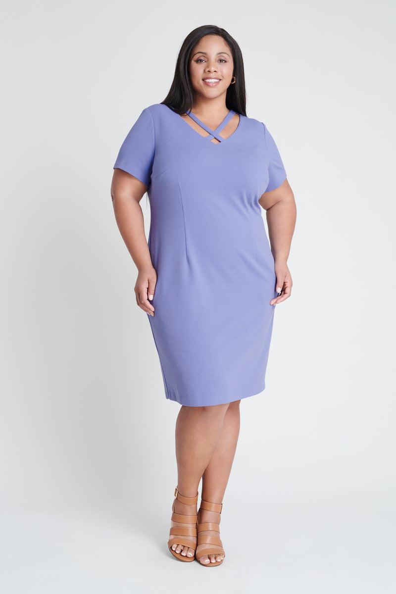 Woman posing wearing Periwinkle Bobbi Periwinkle X-Neck Dress from Connected Apparel