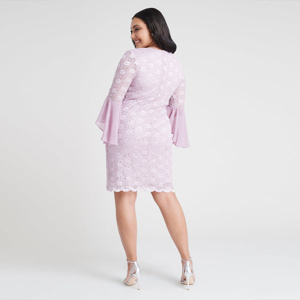 Woman posing wearing Orchid Rachel Orchid Sequin Lace Dress from Connected Apparel