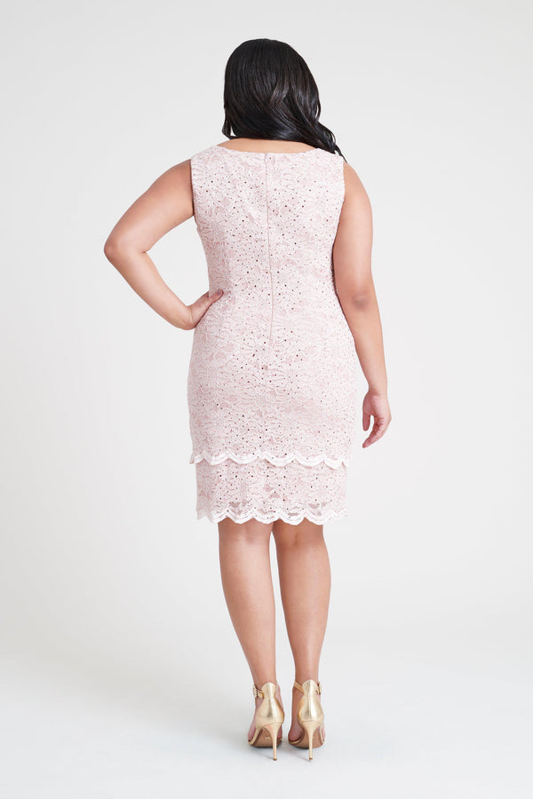 Woman posing wearing Light Pink Remy Light Pink Sequin Lace Dress from Connected Apparel