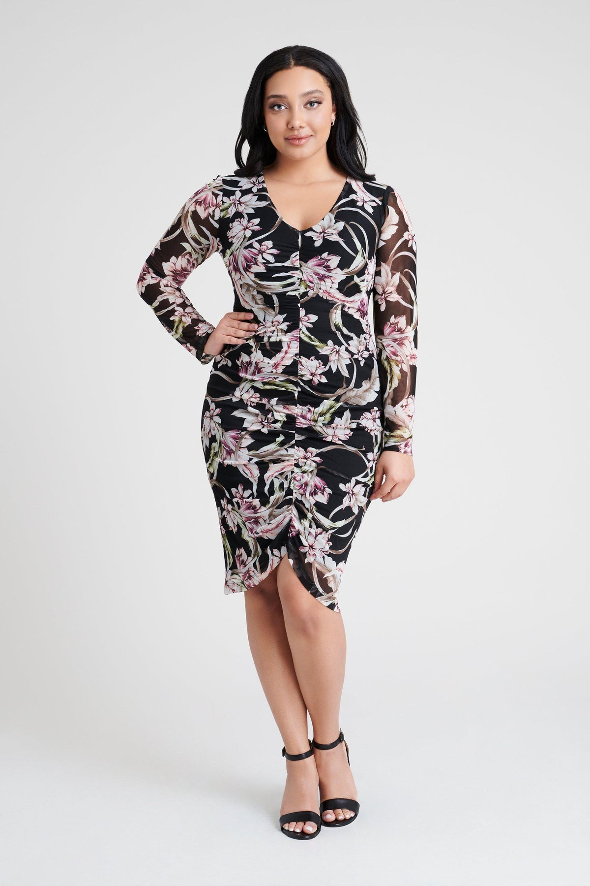 woman-wearing-connected-apparel-Riley Floral Print Dress-posing-on-plain-background