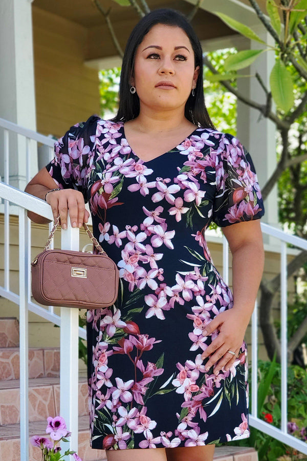 Woman posing wearing Navy/Mauve Sadie Navy & Mauve Floral Print Dress from Connected Apparel