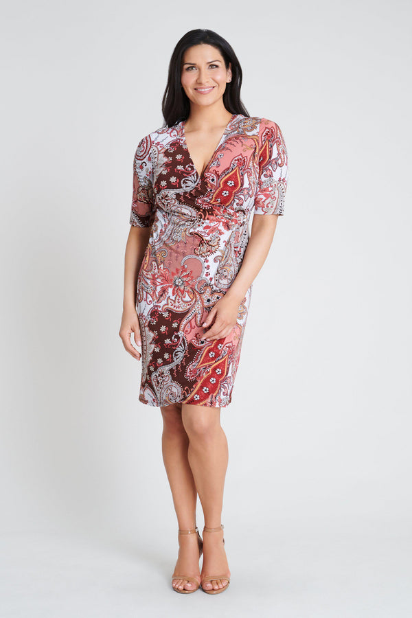 Woman posing wearing Salmon Gina Salmon Paisley Print Dress from Connected Apparel