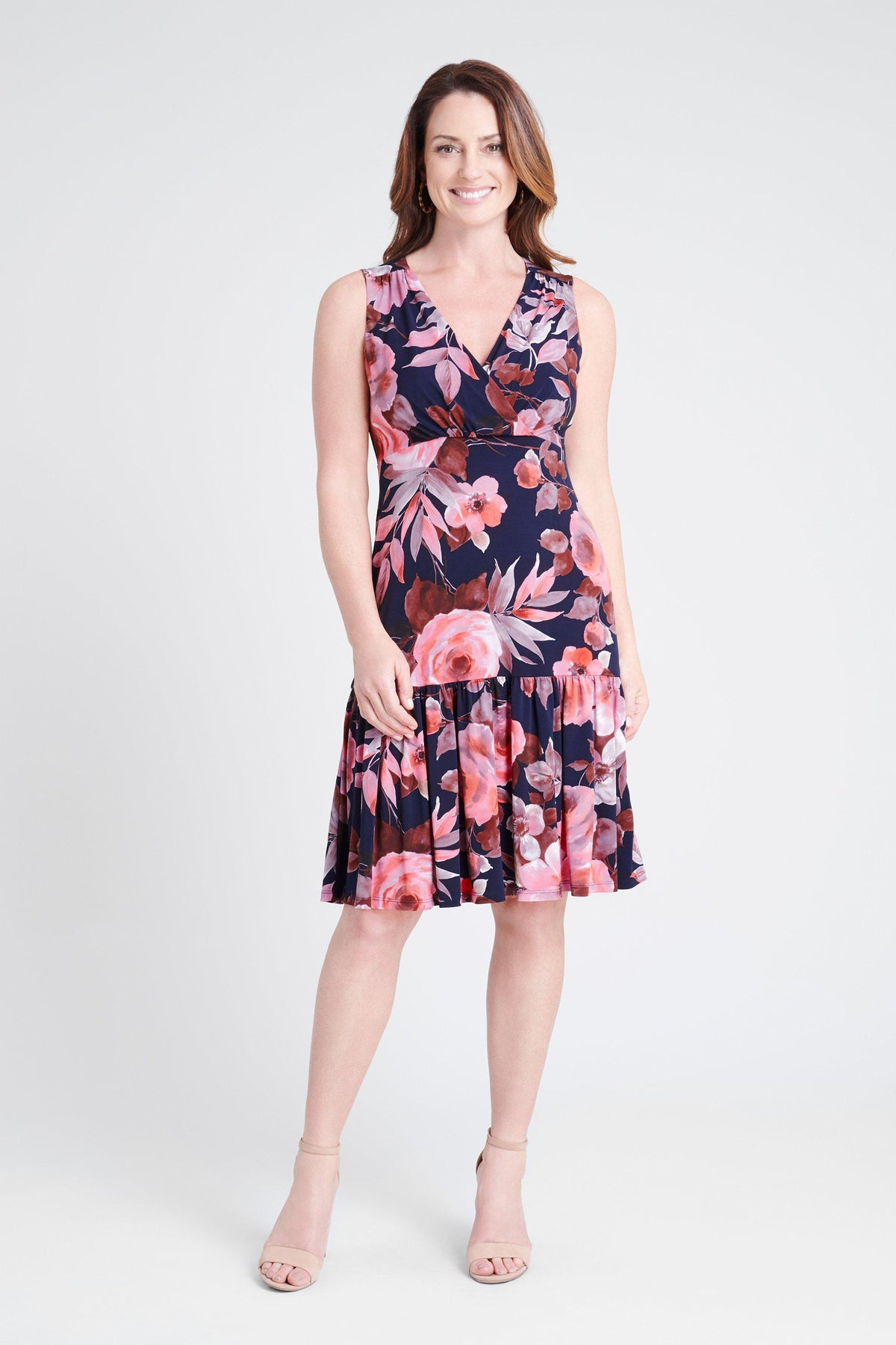 woman-wearing-connected-apparel-Layla Floral Print Dress [PRE-ORDER]-posing-on-plain-background