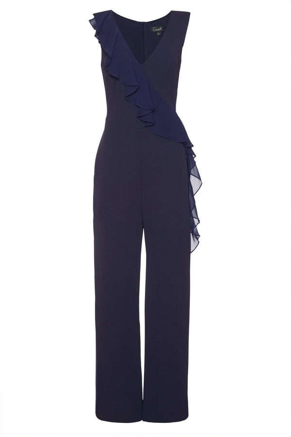 woman-wearing-connected-apparel-Sara Navy Jumpsuit-posing-on-plain-background