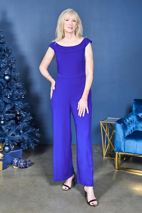 Woman posing wearing Cobalt Serena Cobalt Blue Jumpsuit from Connected Apparel