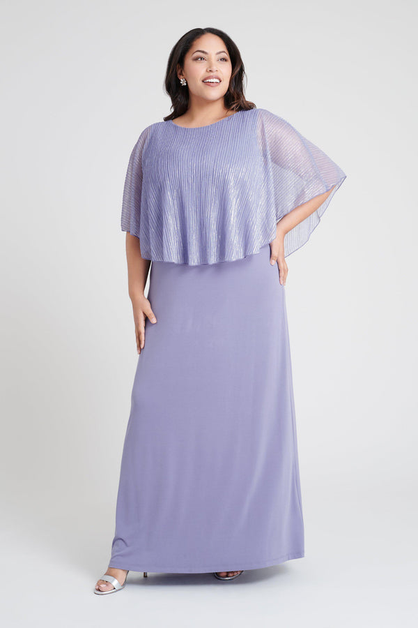 Woman posing wearing Soft Lilac Elsa Soft Lilac Metallic Floor-Length Cape Dress from Connected Apparel