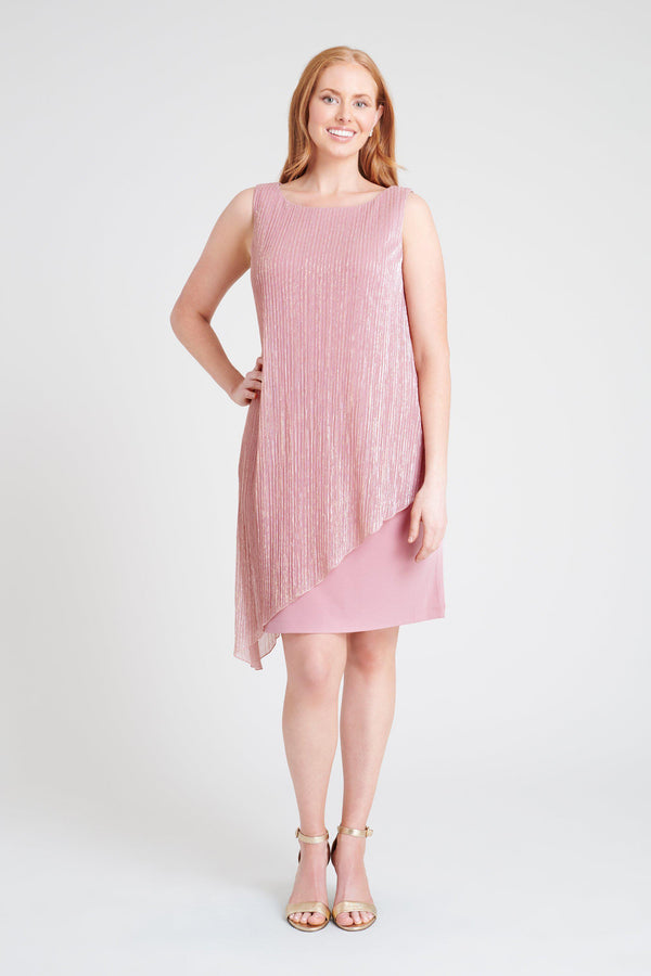 Woman posing wearing Soft Mauve Amelia Soft Mauve Asymmetrical Dress from Connected Apparel