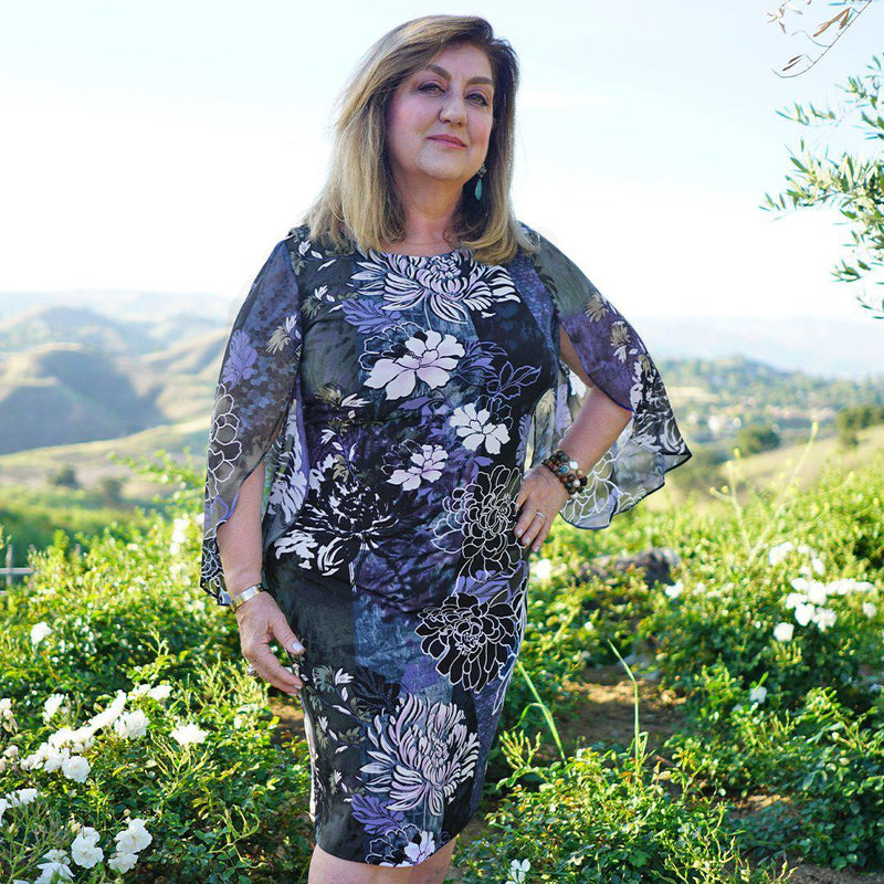 Woman posing wearing Deep Periwinkle Stevie Abstract Floral Print Dress from Connected Apparel