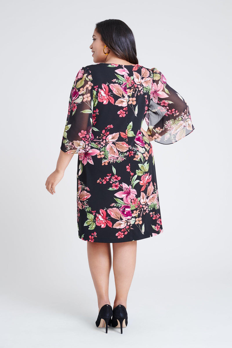 woman-wearing-connected-apparel-Stevie Floral Print Dress [PRE-ORDER]-posing-on-plain-background