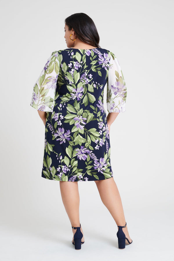 woman-wearing-connected-apparel-Stevie Navy & Lavender Floral Print Dress [PRE-ORDER]-posing-on-plain-background